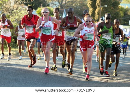 DURBAN, SOUTH AFRICA - MAY 29: Twin sisters Olesya and Elena Nurgalieva (in sunglasses) lead the womens race in the 2011 Comrades Marathon in Durban South Africa on the May 29, 2011. - stock photo