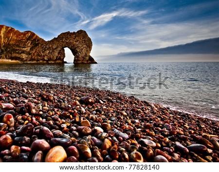 Durdle Door Pebble Beach - stock photo