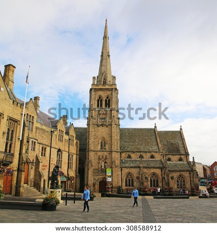 DURHAM, ENGLAND - AUGUST 6, 2015: St Nicholas C. of E. Church in Market Square, Durham. Durham  is a historic city and the county town of County Durham in North East England - stock photo
