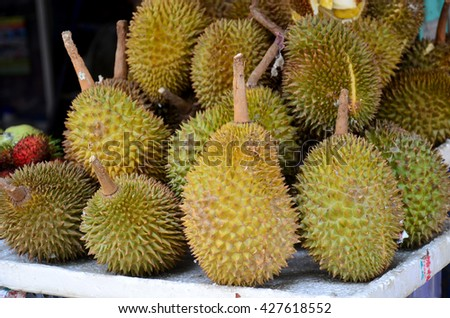 Durian fruits at Fruit Shop or greengrocery on street for sale at market in Luang Prabang, Laos - stock photo