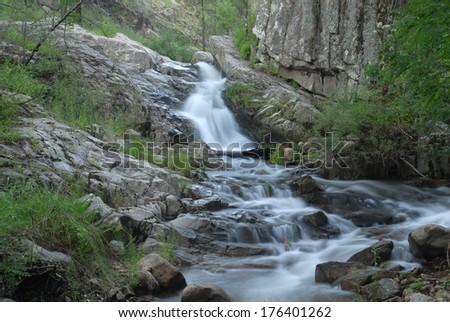 During the monsoons southern Arizona has many waterfalls and streams. - stock photo