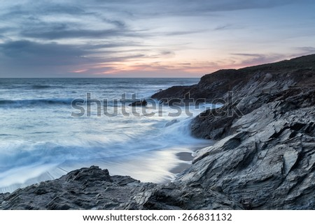 Dusk falls over Little Fistrala rocky cove just off the main Fistral Beach at Newquay in Cornwall - stock photo