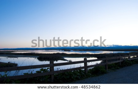 Dusk falls over the wetlands of the Sacramento National Wildlife Refuge in the California Central Valley. - stock photo
