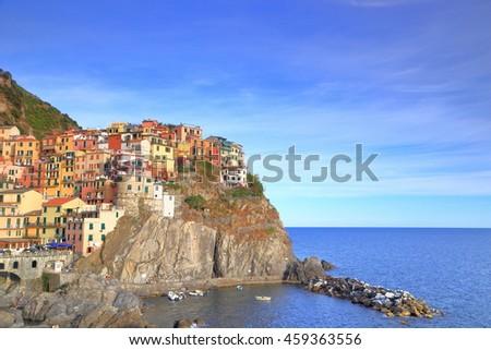 Dusk light cover the harbor and village of Manarola, Cinque Terre, Italy - stock photo