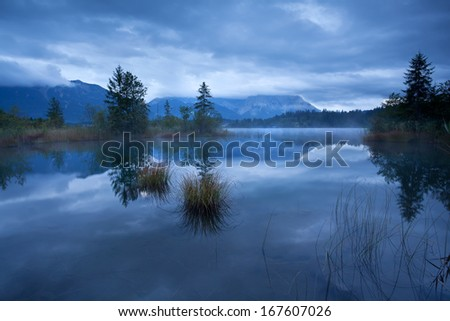dusk on Barmsee lake in Alps, Bavaria, Germany - stock photo