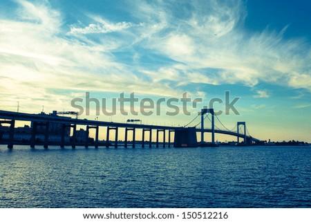 Dusk over Long Island Sound and Throgs Neck Bridge in New York City - stock photo
