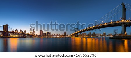 "Dusk panorama with the downtown New York City skyline and the ""Two Bridges"": Brooklyn Bridge and Manhattan Bridge, viewed from Brooklyn Bridge Park, across the East River (41Mpx) - stock photo"