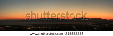 Dusk sky above city lights in a panoramic landscape., Provo, Utah, USA. - stock photo