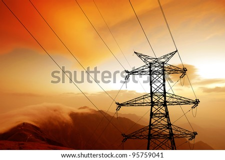 Dusk, the mountains of the high-voltage tower. - stock photo