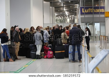 Dusseldorf Airport,Germany.March 21,2013. Queues of people form in front of check in desks due to a strike in Dusseldorf airport.Lufthansa employees on strike.  - stock photo