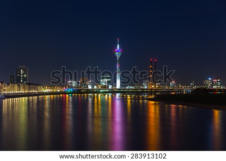 Dusseldorf at night on the rhine river in germany - stock photo