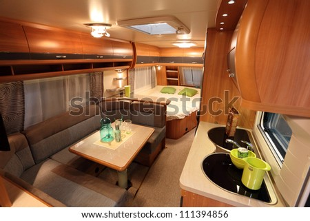 DUSSELDORF - AUGUST 27: Interior of a modern camper van at the Caravan Salon Exhibition 2012 on August 27, 2012 in Dusseldorf, Germany - stock photo