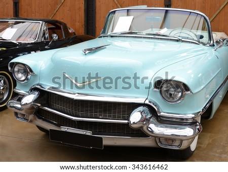 DUSSELDORF, GERMANY APRIL17, 2015: Retro car Kadilak in shop- gallery of  old cars  in Dusseldorf, Germany.  - stock photo