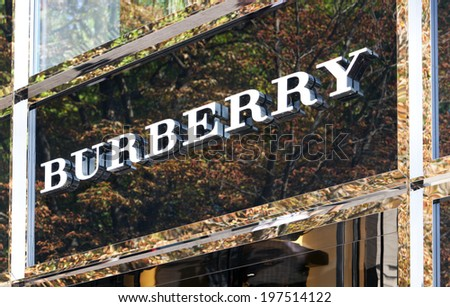 Dusseldorf, Germany - August 20,2011: Burberry logo above store entrance on Koenigsallee. Burberry Group plc is a British luxury fashion house, manufacturing clothing, fragrance, and accessories. - stock photo