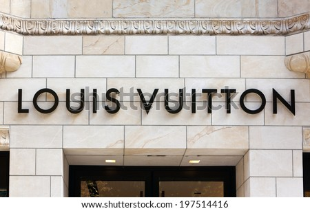 Dusseldorf, Germany - August 20, 2011: Louis Vuitton sign at store on Koenigsallee. Louis Vuitton Malletier is a french fashion house founded in 1854, today belonging to LVMH group. - stock photo