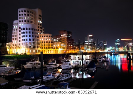 DUSSELDORF, GERMANY - FEB 16: Night view of Dusseldorf harbor on 16 Feb, 2011.The Hafen district itself contains some spectacular post-modern architecture, most famously constructions by Frank Gehry - stock photo