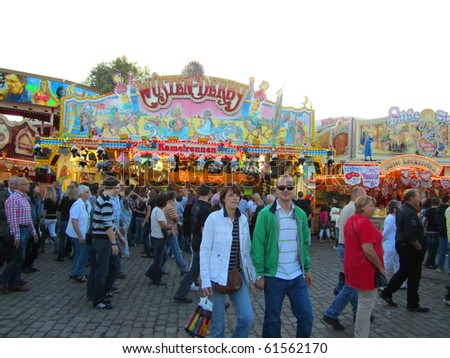 DUSSELDORF, GERMANY - JULY 24: Unidentified visitors at Kirmes on July 24, 2010 in Dusseldorf, Germany. Kirmes is the biggest summer fair on the north Rhein in Germany. - stock photo