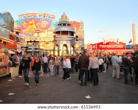 DUSSELDORF, GERMANY - JULY 24:  Visitors at Kirmes on July 24, 2010 in Dusseldorf, Germany. Kirmes is the biggest summer fair on the north Rhein in Germany. - stock photo