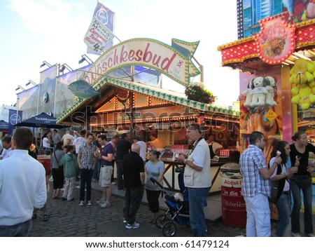 DUSSELDORF, GERMANY - JULY 24: Visitors Hotdog Stall at Kirmes on July 24, 2010 in Dusseldorf, Germany. Kirmes is the biggest summer fair on the north Rhein in Germany. - stock photo