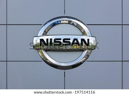 Dusseldorf, Germany - June 12, 2011: Nissan logo at the wall of car dealer's building. Nissan Motor Company Ltd is a multinational car manufacturer headquartered in Yokohama, Japan. - stock photo