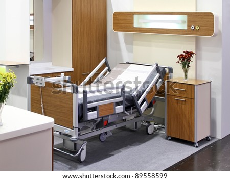 DUSSELDORF, GERMANY - NOVEMBER 19: Hospital bedroom on the MEDICA 2011: the world's largest medical trade fair, November 19, 2011 in Dusseldorf, Germany.
