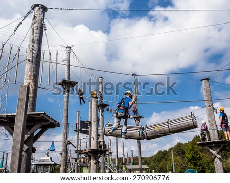 Dusseldorf, Germany - September 14, 2014: People at rope park climbing during Alp national holiday in Dusseldorf, Germany