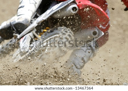 dust and small stones during a motocross race - stock photo