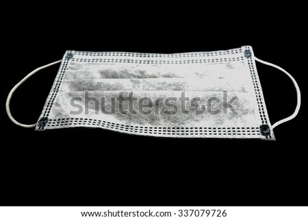 Dust mask for protection against germs on black background.