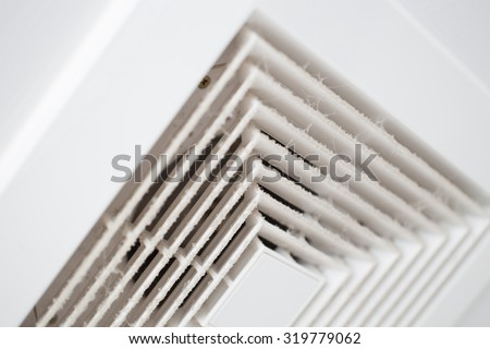 Dust out from Air Duct, Danger and the cause of pneumonia in office man, selective focus on dust particle. - stock photo