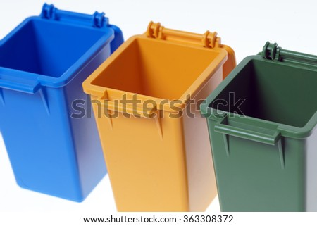 Dustbins in the colors blue, yellow and green / Dustbins - stock photo