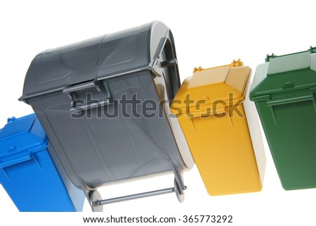 Dustbins in the colors blue, yellow , green and silver / Dustbins - stock photo