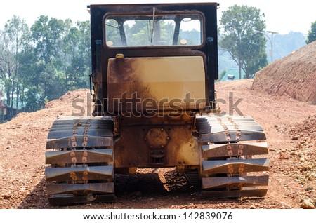 Dusty big bulldozer, isolated on pure - stock photo
