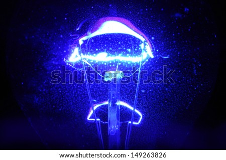 dusty blue light bulb - stock photo