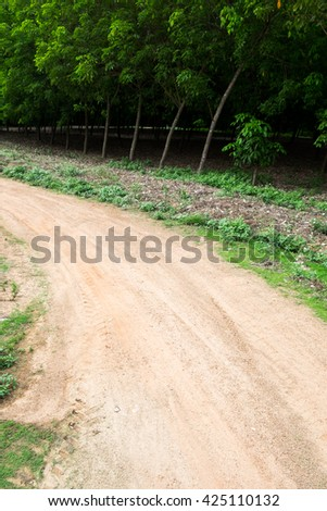 Dusty country road - stock photo