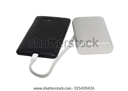 dusty mobile phone and an external battery on a white background - stock photo