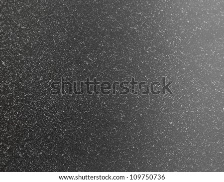 Dusty surface of a computer monitor's screen.