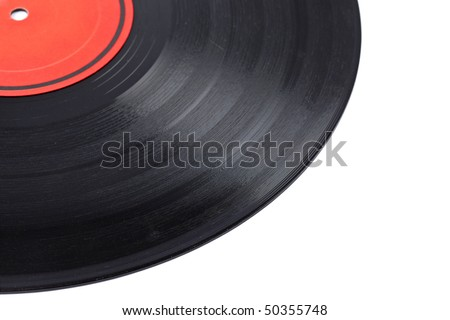 Dusty vinyl record with red label isolated on white background. Shallow depth of field