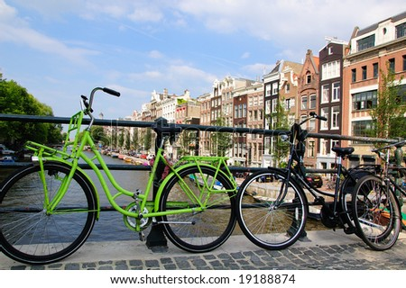 Dutch bicycles on a bridge in Amsterdam - stock photo