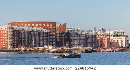 Dutch contemporary apartment buildings in Amsterdam alongside the river IJ at the KNSM island - stock photo