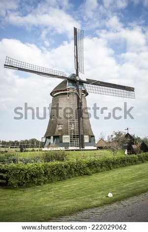 Dutch countryside scenery with a windmill - stock photo