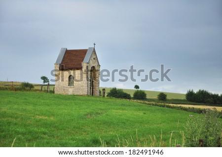 Dutch countryside - Small brick stone field chapel in Limburg, The Netherlands - stock photo