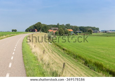 Dutch countryside with inland dike and meadows - stock photo