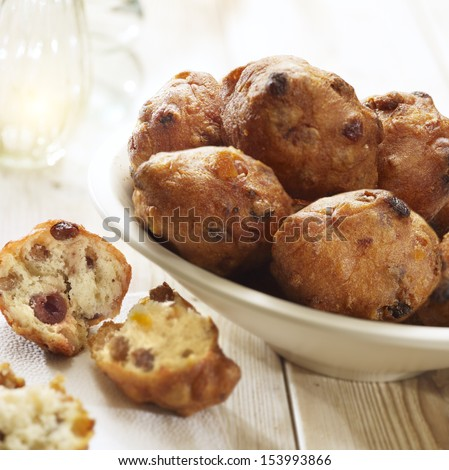 dutch dough nut with raisins traditionally eaten with new years eve served in a bowl - stock photo