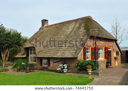 Dutch farm house whit an thatched roof - stock photo
