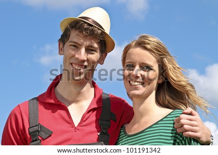 Dutch farmer and his wife in the countryside