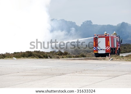 Dutch fire fighter truck in action. - stock photo