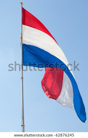 Dutch flag against the blue sky