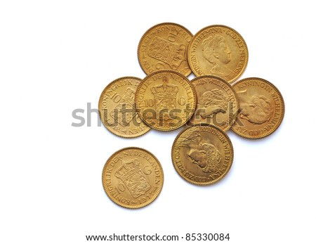 Dutch gold coins 10 guilder - from The Netherlands - stock photo