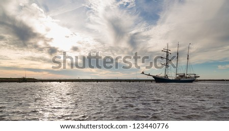 Dutch harbor of Urk with sunset and sailing ship - stock photo