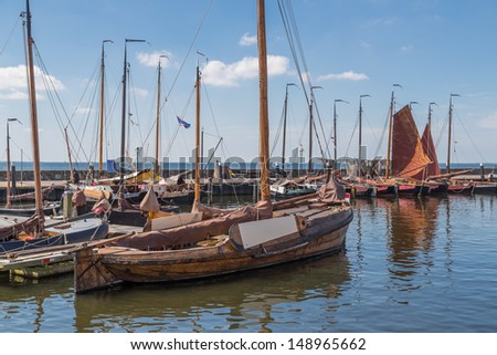 Dutch harbor of Urk with traditional wooden fishing boats - stock photo